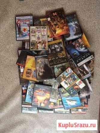 Продам 57 дисков в играми и фильмами Псков