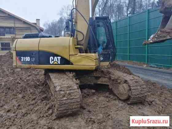 Гусеничный экскаватор Caterpillar 319DLN Москва